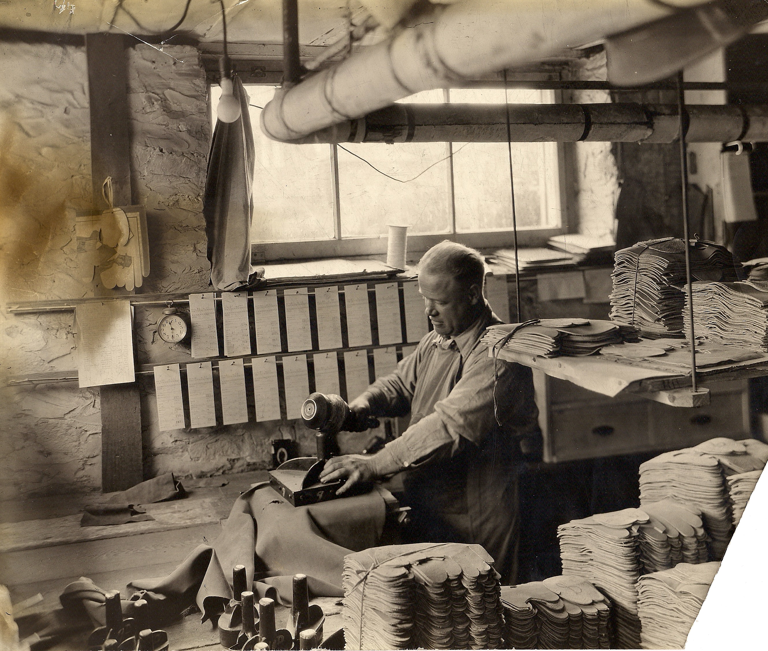 Ivan Doty cutting out glove stock with hand held die 1922